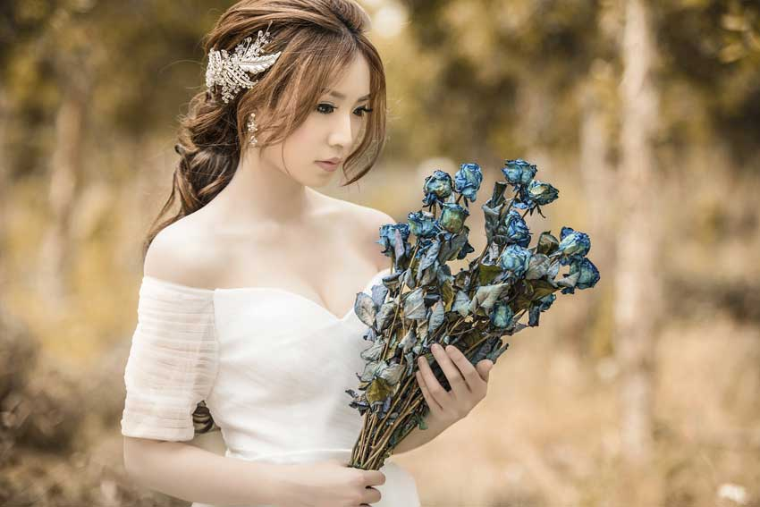 Bride Wearing a White Dress with Flowers